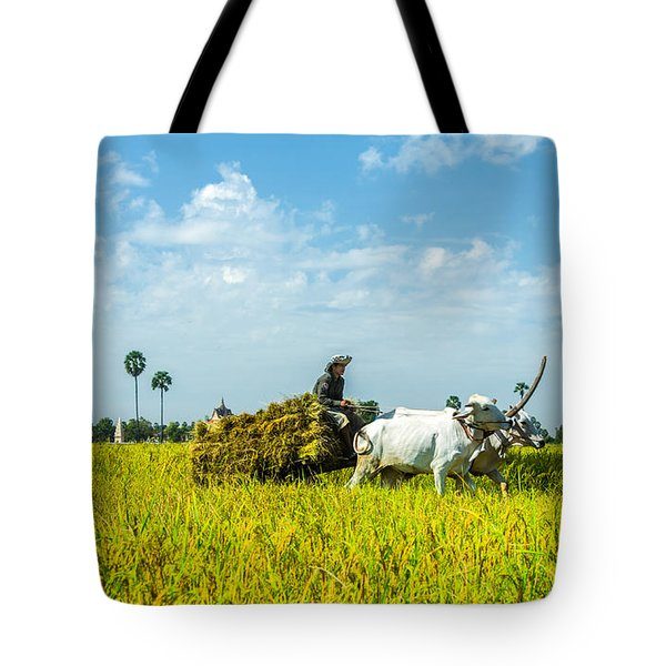Farmer Carrying Rice With Cow Tote Bag