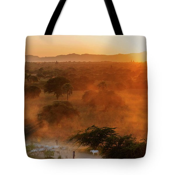 Tote Bag featuring the photograph Farmer Returning To Village In The Evening by Pradeep Raja Prints