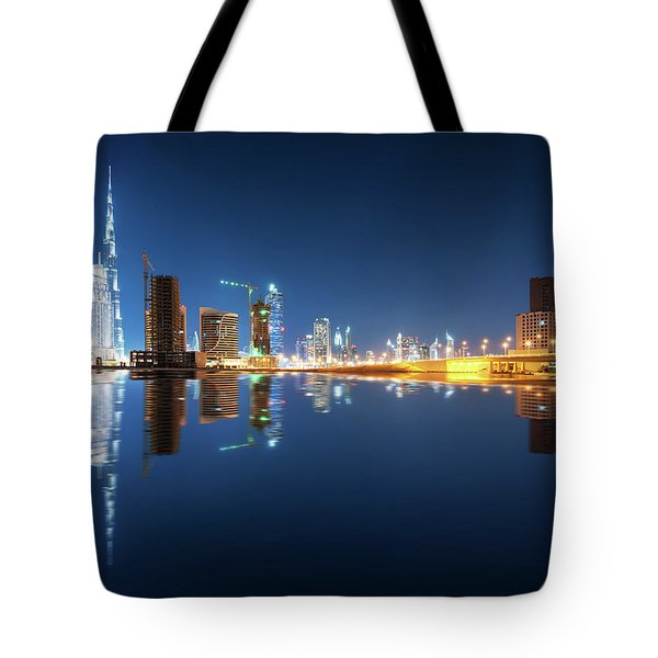 Fascinating Reflection Of Tallest Skyscrapers In Business Bay District During Calm Night. Dubai, United Arab Emirates. Tote Bag