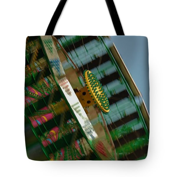 Tote Bag featuring the photograph Faster And Faster We Go by Ramona Whiteaker