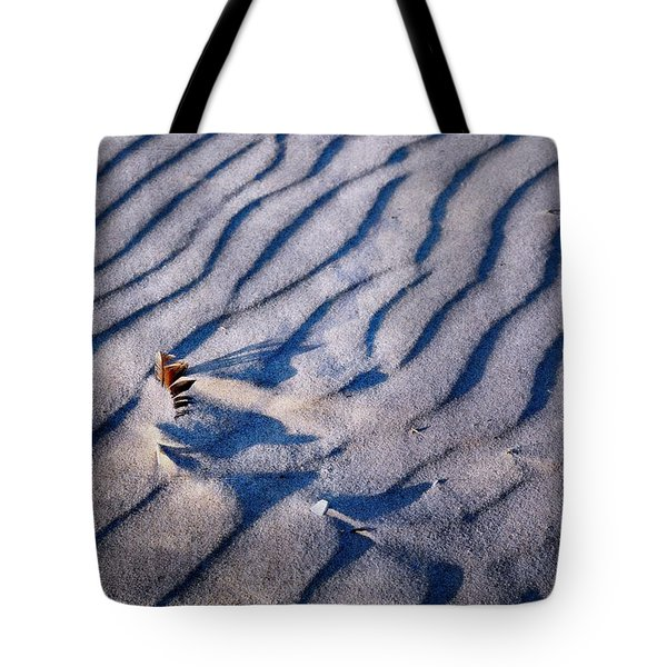 Tote Bag featuring the photograph Feather In Sand by Michelle Calkins