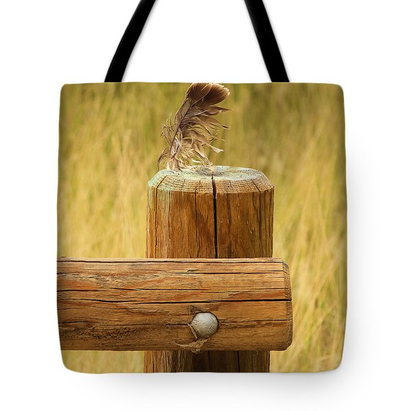 Tote Bag featuring the photograph Feather On Wooden Fence by Viktor Savchenko