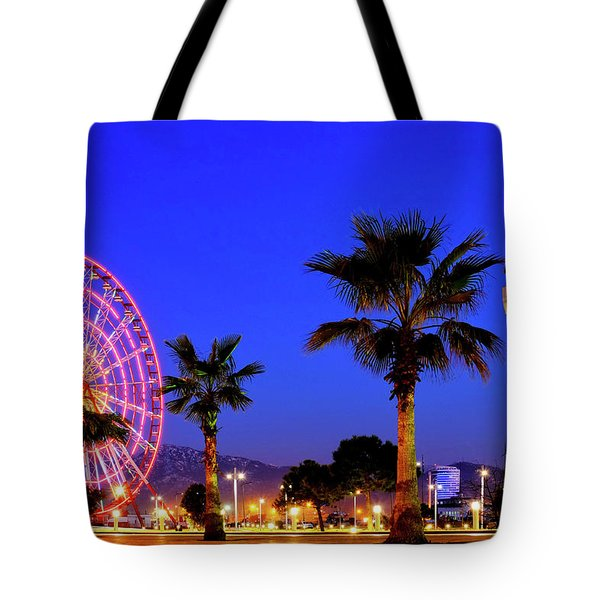 Tote Bag featuring the photograph Ferris Wheel And Lighthouse by Fabrizio Troiani