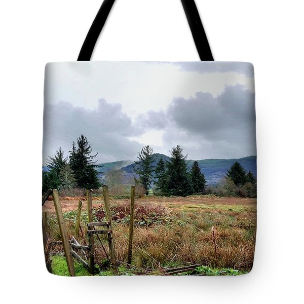Field, Clouds, Distant Foggy Hills Tote Bag