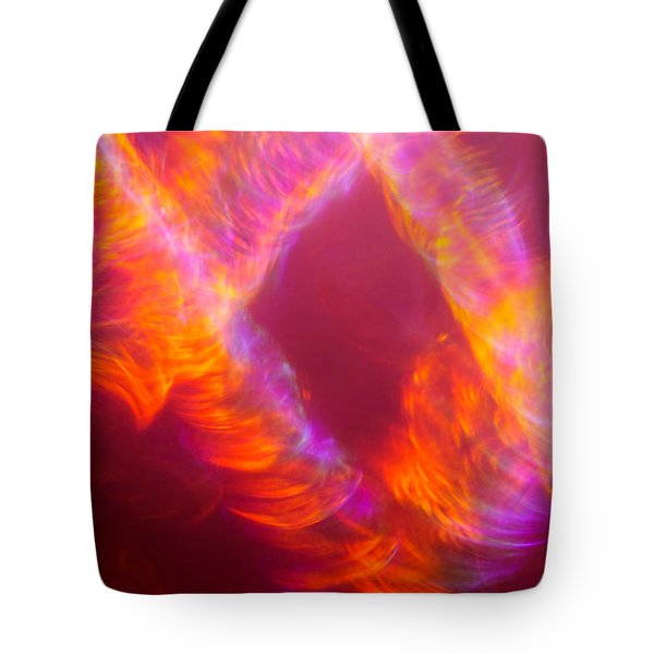Tote Bag featuring the photograph Fiery Cyclonic Fury by Greg Collins
