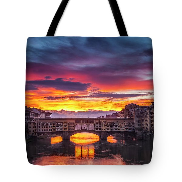 Tote Bag featuring the photograph Fiery Sunrise Over Ponte Vecchio by Andrew Soundarajan