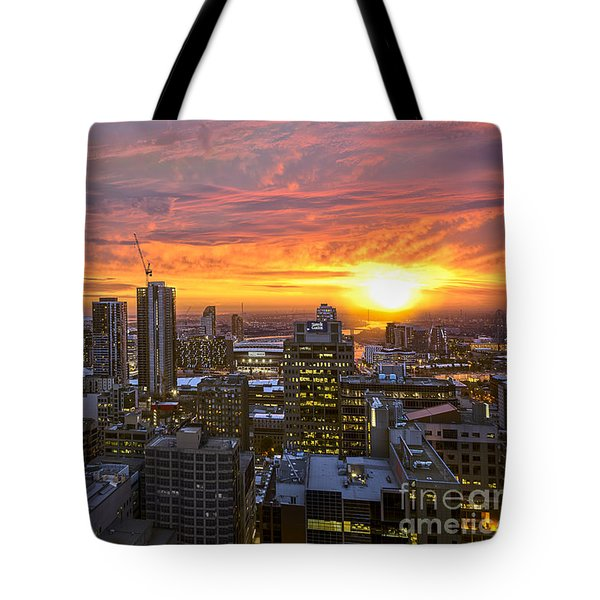 Tote Bag featuring the photograph Fiery Sunset by Ray Warren