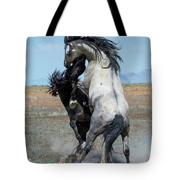 Tote Bag featuring the photograph Fighting Black And Gray Stallions by Mary Hone