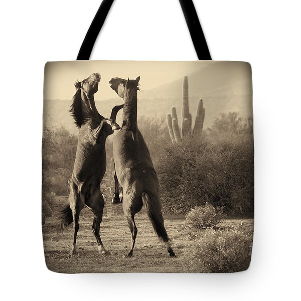 Tote Bag featuring the photograph Fighting Stallions by Frank Stallone