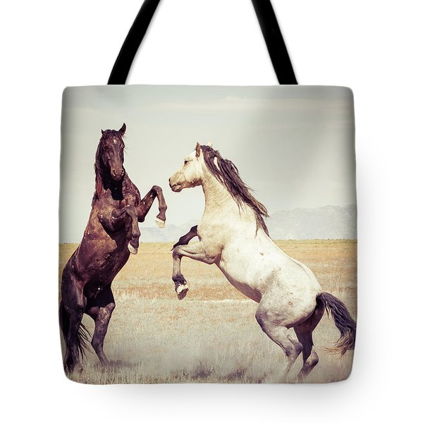 Tote Bag featuring the photograph Fighting Stallions by Mary Hone