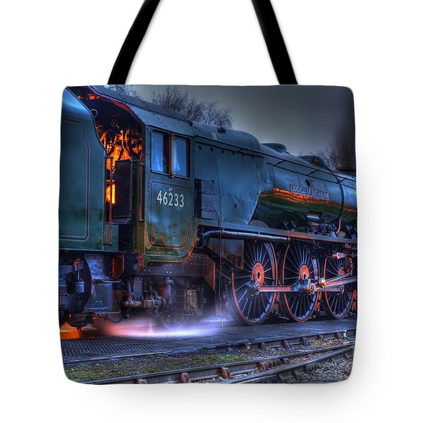 Tote Bag featuring the photograph Fire In Her Belly by David Birchall