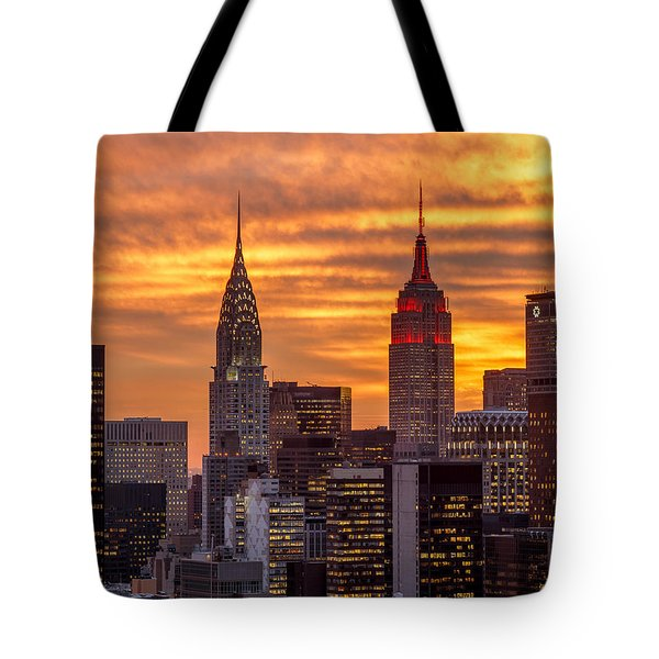 Tote Bag featuring the photograph Fire In The Sky by Anthony Fields