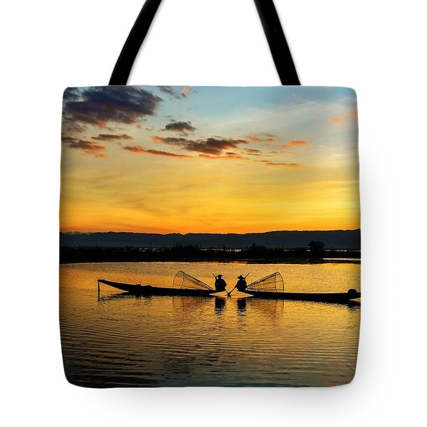 Tote Bag featuring the photograph Fisherman On Their Boat by Pradeep Raja Prints