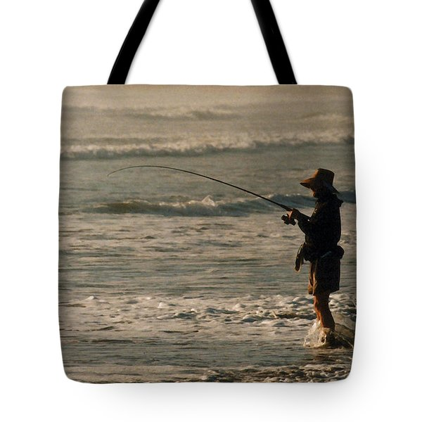 Tote Bag featuring the photograph Fisherman by Steve Karol