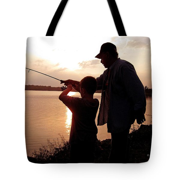 Tote Bag featuring the photograph Fishing At Sunset Grandfather And Grandson by A Gurmankin