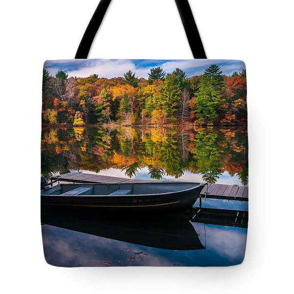 Tote Bag featuring the photograph Fishing Boat On Mirror Lake by Rikk Flohr