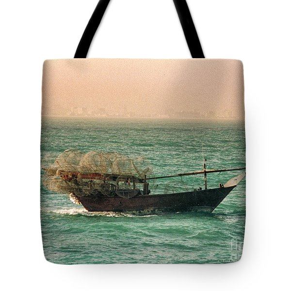 Tote Bag featuring the photograph Fishing Dhow by Charles McKelroy
