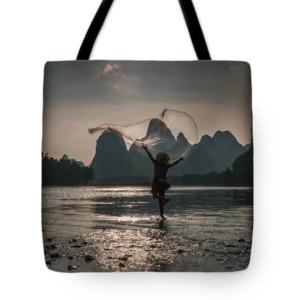 Fisherman Casting A Net. Tote Bag