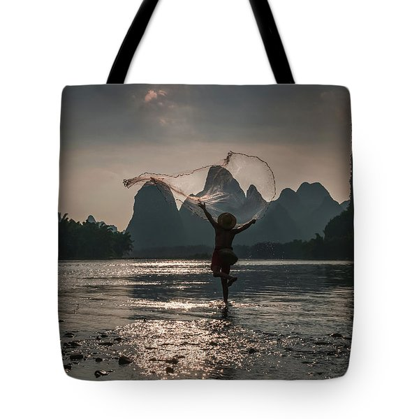 Fisherman Casting A Net. Tote Bag