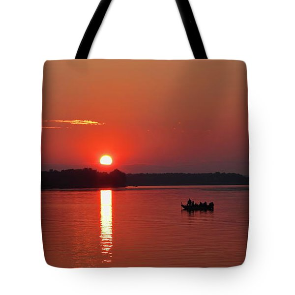 Tote Bag featuring the photograph Fishing Until Sunset by Dale Kauzlaric