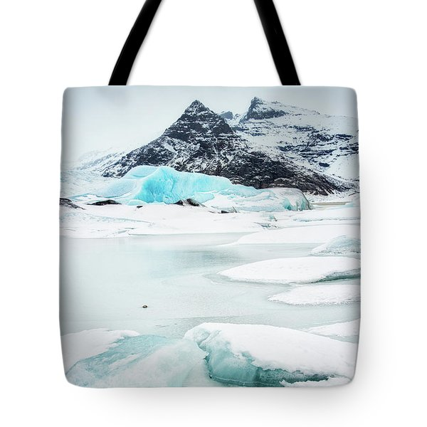 Tote Bag featuring the photograph Fjallsarlon Glacier Lagoon Iceland In Winter by Matthias Hauser