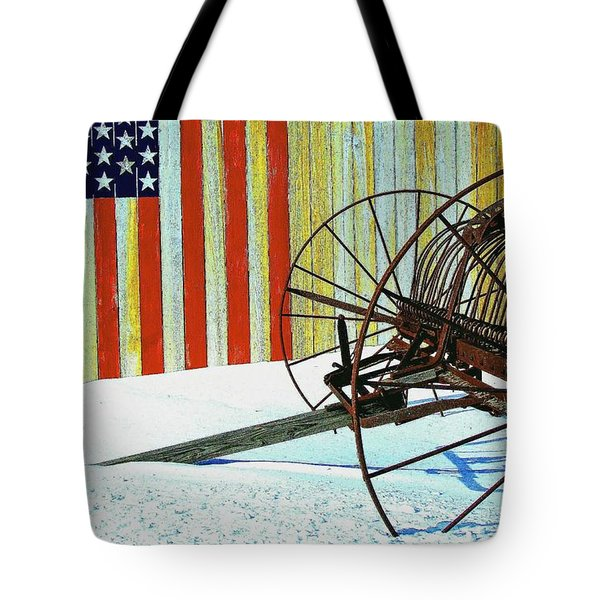 Tote Bag featuring the photograph Flag And The Wheel by John Hartman