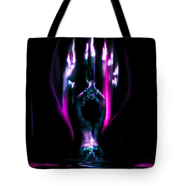 Tote Bag featuring the photograph Flame Dance by Glenn Feron