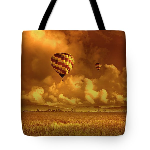 Tote Bag featuring the photograph Flaming Sky by Charuhas Images