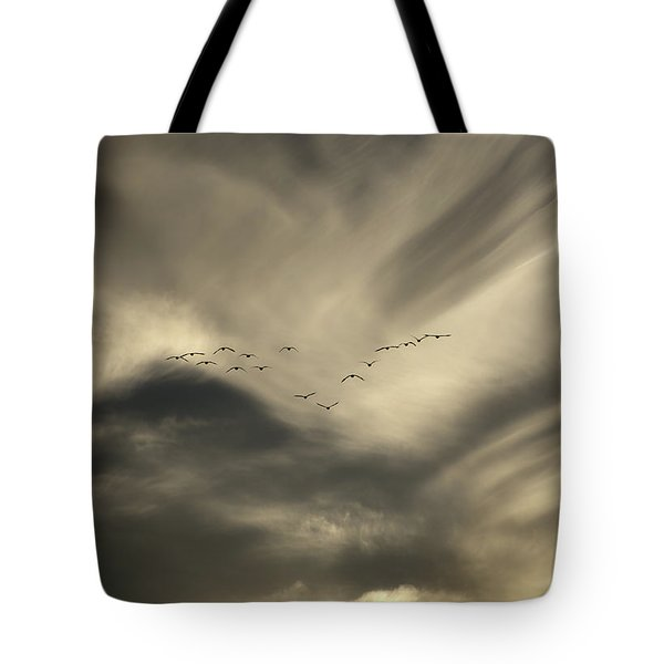 Tote Bag featuring the photograph Flight 016 Westbound by Robert Geary