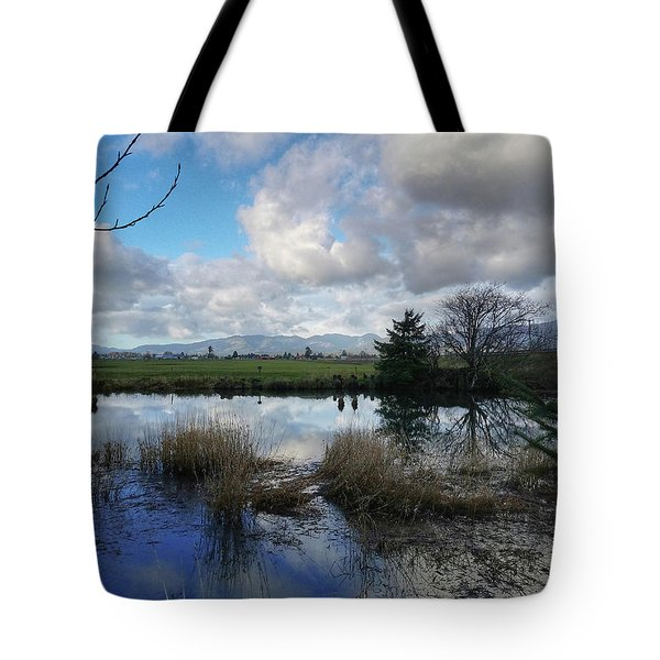 Flooding River, Field And Clouds Tote Bag