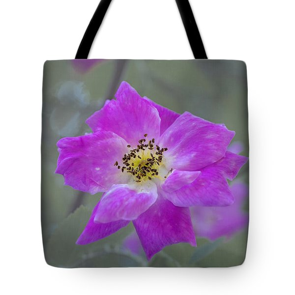 Tote Bag featuring the photograph Flower In Pink by Tom Singleton
