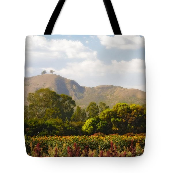 Tote Bag featuring the photograph Flowers And Two Trees by John A Rodriguez