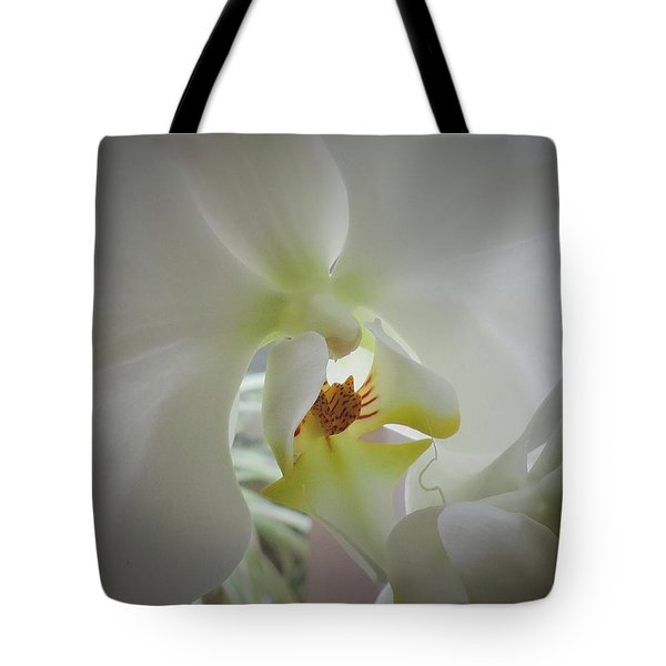 Tote Bag featuring the photograph Flowing Flower by Peggy Stokes