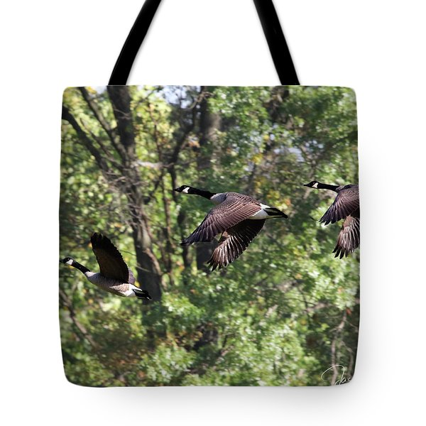 Tote Bag featuring the photograph Fly Away by Jackson Pearson