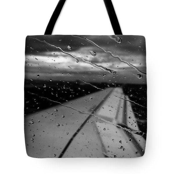 Tote Bag featuring the photograph Fly Away On A Rainy Day by Chris Feichtner