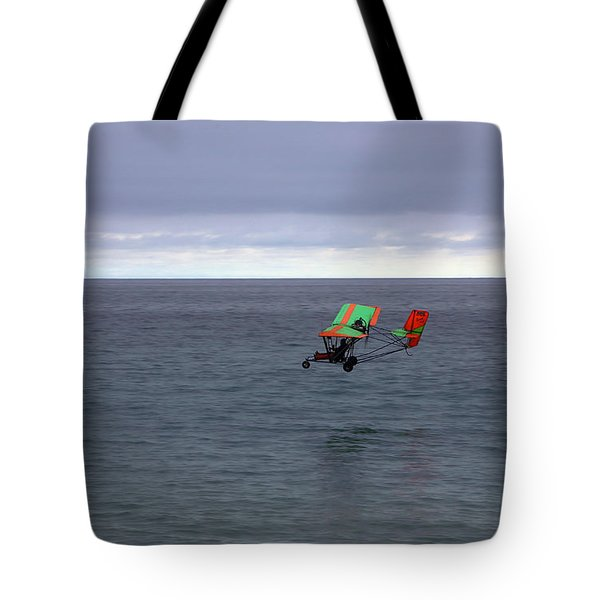 Tote Bag featuring the photograph Fly Over Mugu Point by Viktor Savchenko