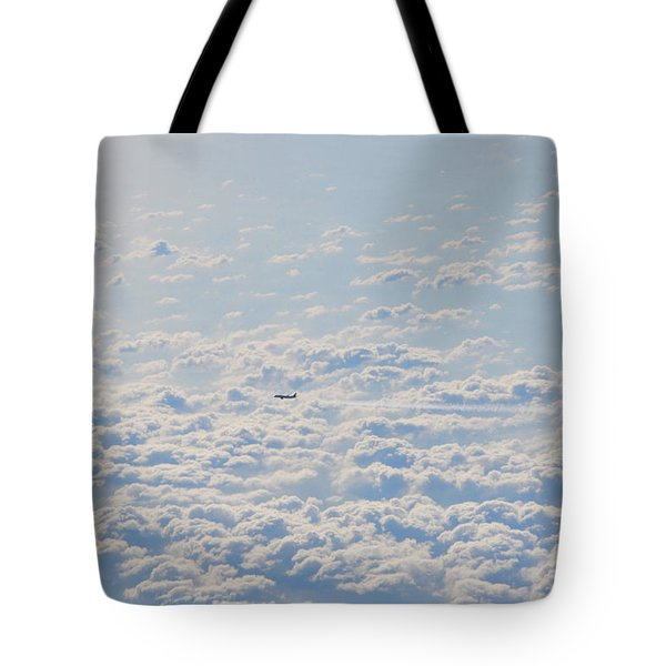Tote Bag featuring the photograph Flying Among The Clouds by Bill Cannon