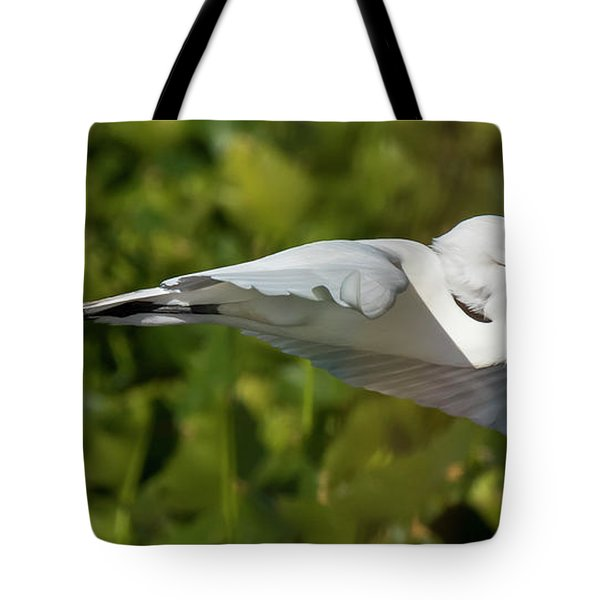 Tote Bag featuring the photograph Flying Great Egret With Fish by Michael D Miller