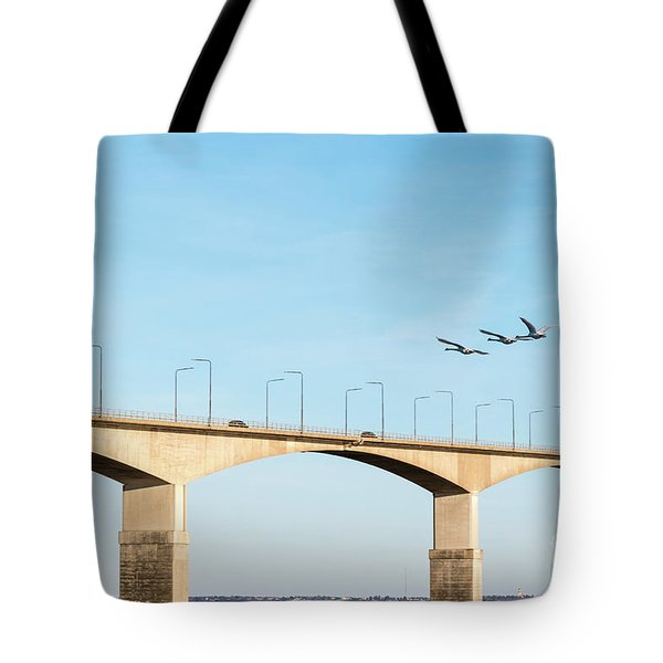 Tote Bag featuring the photograph Flying Swans By The Bridge by Kennerth and Birgitta Kullman