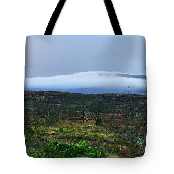 Tote Bag featuring the photograph Fog Rolling Across The Sperrins by Colin Clarke