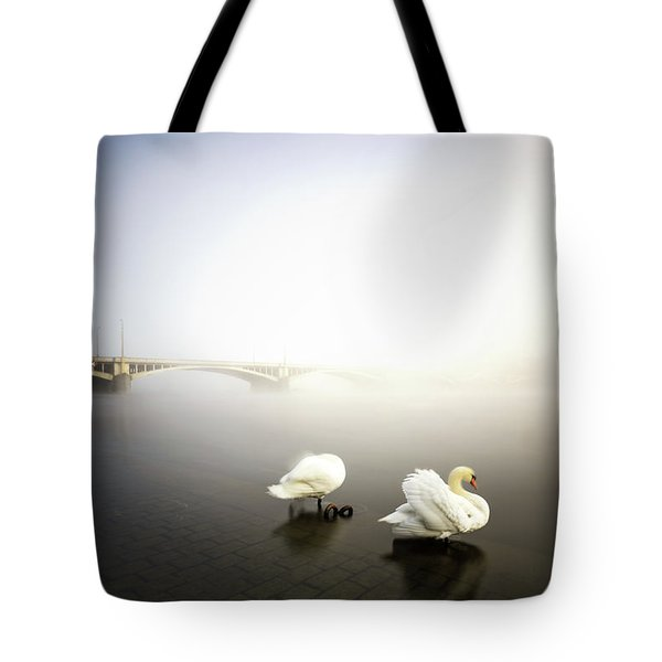 Foggy Morning View Near Bridge With Two Swans At Vltava River, Prague, Czech Republic Tote Bag