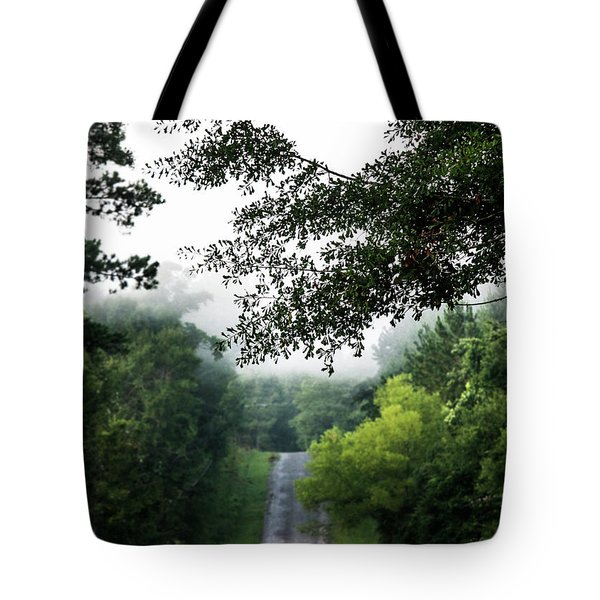 Tote Bag featuring the photograph Foggy Road To Eternity  by Shelby Young