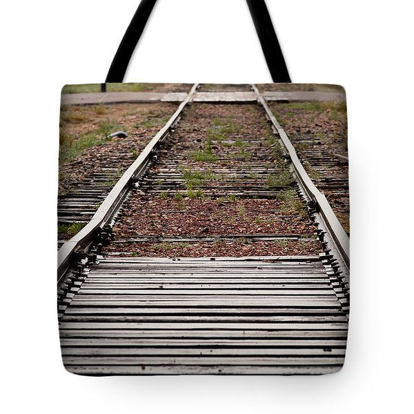 Tote Bag featuring the photograph Following The Tracks by Monte Stevens