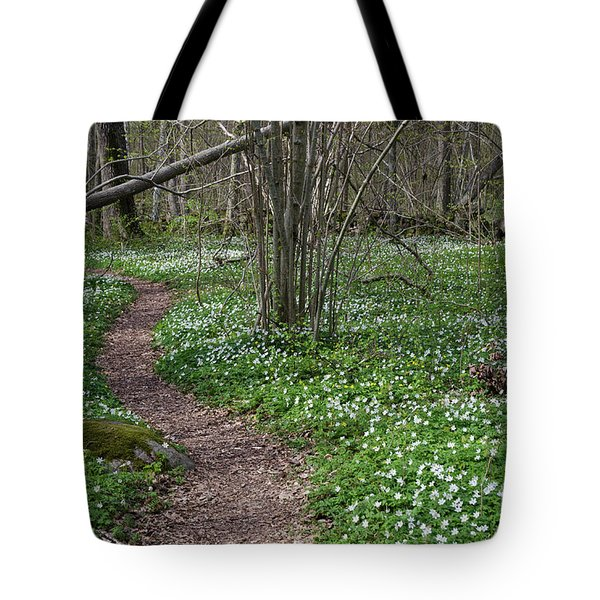 Tote Bag featuring the photograph Footpath Through A Flower Covered Forest by Kennerth and Birgitta Kullman