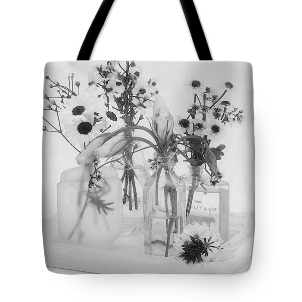 Four Bottles And Their Flowers Tote Bag by Sandra Foster