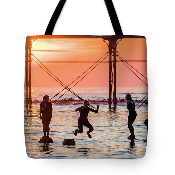 Four Girls Jumping Into The Sea At Sunset Tote Bag