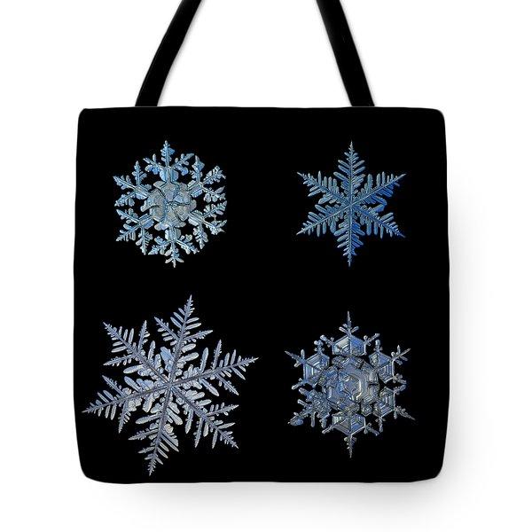 Four Snowflakes On Black Background Tote Bag
