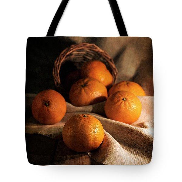 Fresh Tangerines In Brown Basket Tote Bag by Jaroslaw Blaminsky