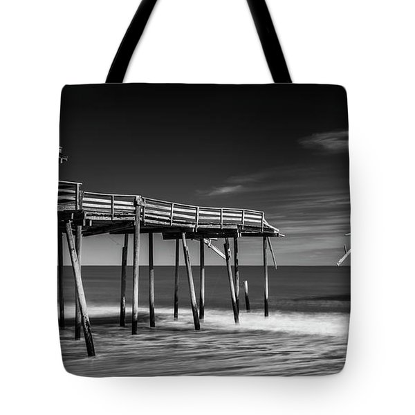 Tote Bag featuring the photograph Frisco Fishing Pier In Black And White Panorama by Ranjay Mitra