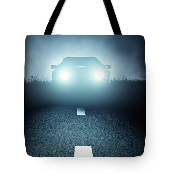 Front Car Lights At Night On Open Road Tote Bag